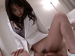 Asian nurse Ayumi Iwasa devours cock between her hands