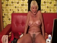 Blistering granny plays with milk. See more at 747cams.com