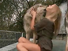 Horny and horny mistress kisses a dog on the porch of the house